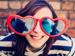 Teenage girl wearing heart sunglasses